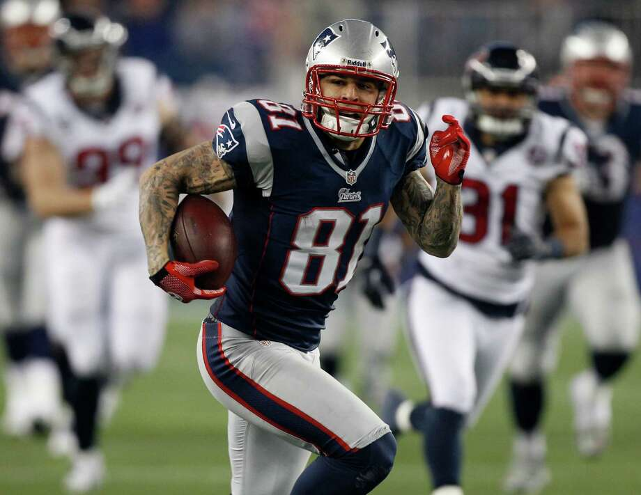 New England Patriots tight end Aaron Hernandez runs after a catch during the second half of an AFC divisional playoff NFL football game against the Houston Texans in Foxborough, Mass., Sunday, Jan. 13, 2013. (AP Photo/Stephan Savoia) Photo: Stephan Savoia, Associated Press / AP