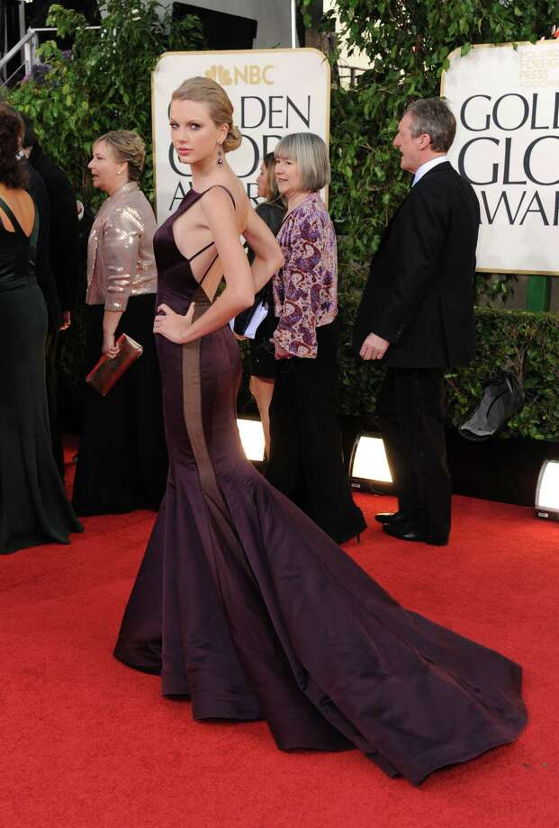 Singer Taylor Swift arrives at the 70th Annual Golden Globe Awards at the Beverly Hilton Hotel on Sunday Jan. 13, 2013, in Beverly Hills, Calif. (Photo by Jordan Strauss/Invision/AP) Photo: Jordan Strauss, Associated Press / Invision