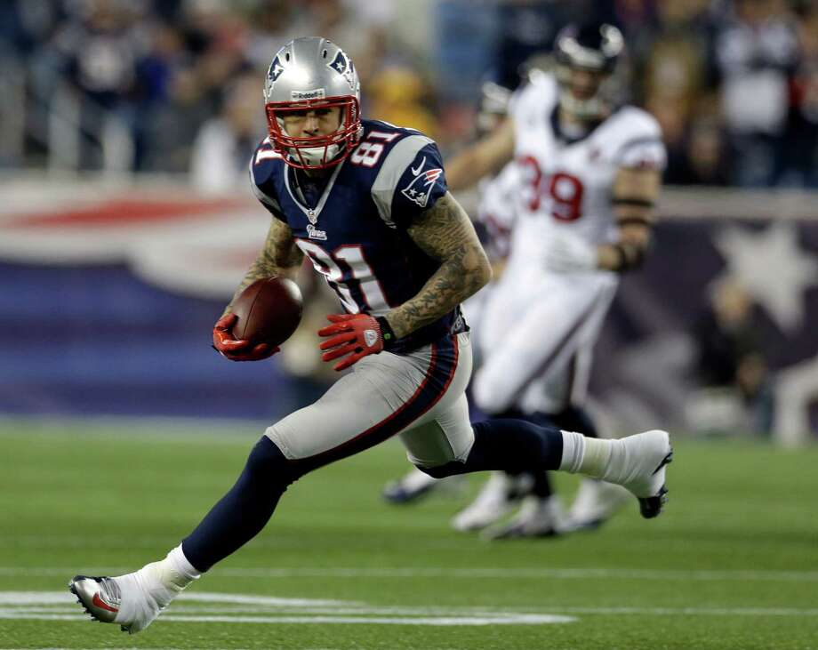 New England Patriots tight end Aaron Hernandez runs after a catch during the second half of an AFC divisional playoff NFL football game against the Houston Texans in Foxborough, Mass., Sunday, Jan. 13, 2013. (AP Photo/Elise Amendola) Photo: Elise Amendola, Associated Press / AP