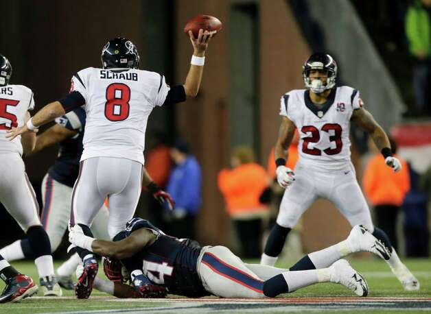 Houston Texans quarterback Matt Schaub (8) gets a pass off to Arian Foster (23) while being tackled by New England Patriots defensive end Justin Francis during the second half of an AFC divisional playoff NFL football game in Foxborough, Mass., Sunday, Jan. 13, 2013. (AP Photo/Charles Krupa) Photo: Charles Krupa, Associated Press / AP
