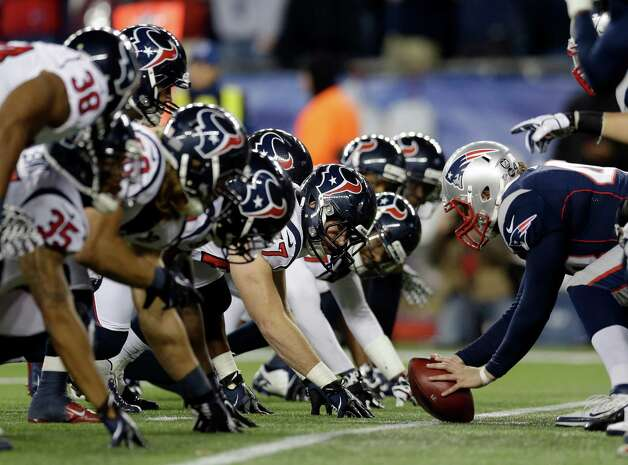 The Houston Texans defense awaits the snap during the second half of an AFC divisional playoff NFL football game against the New England Patriots in Foxborough, Mass., Sunday, Jan. 13, 2013. (AP Photo/Elise Amendola) Photo: Elise Amendola, Associated Press / AP