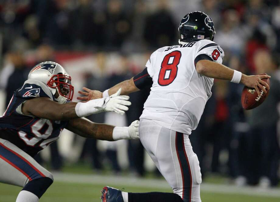 Houston Texans quarterback Matt Schaub evades a tackle by New England Patriots defensive end Justin Francis (94) during the second half of an AFC divisional playoff NFL football game in Foxborough, Mass., Sunday, Jan. 13, 2013. (AP Photo/Stephan Savoia) Photo: Stephan Savoia, Associated Press / AP