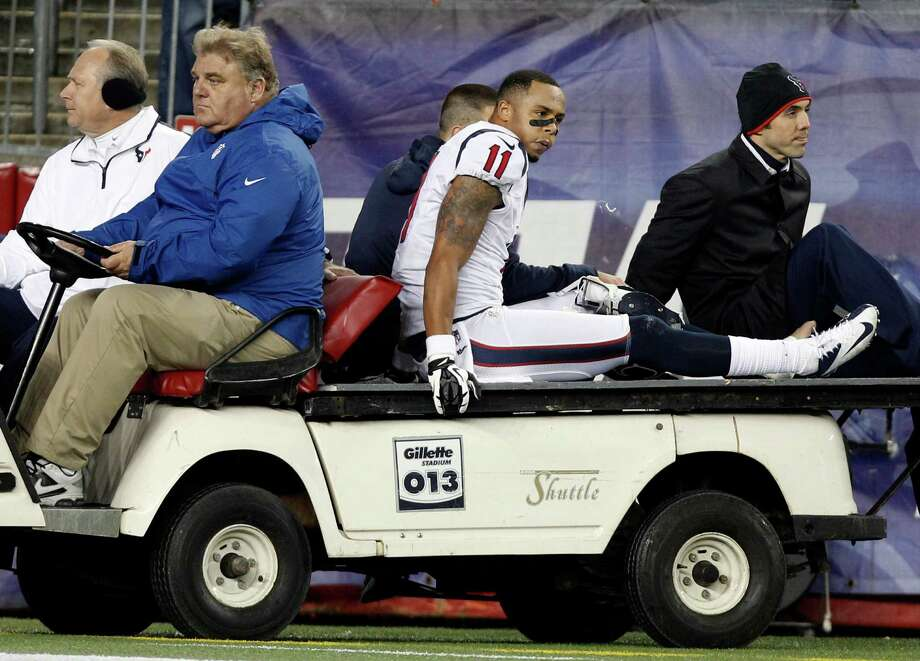 Houston Texans wide receiver DeVier Posey is taken off the field on a cart after an injury during the second half of an AFC divisional playoff NFL football game against the New England Patriots in Foxborough, Mass., Sunday, Jan. 13, 2013. (AP Photo/Stephan Savoia) Photo: Stephan Savoia, Associated Press / AP