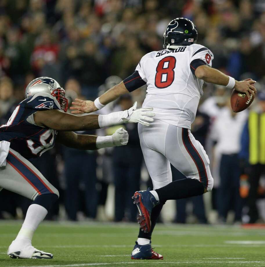 Houston Texans quarterback Matt Schaub (8) evades a tackle by New England Patriots defensive end Justin Francis during the second half of an AFC divisional playoff NFL football game in Foxborough, Mass., Sunday, Jan. 13, 2013. (AP Photo/Elise Amendola) Photo: Elise Amendola, Associated Press / AP