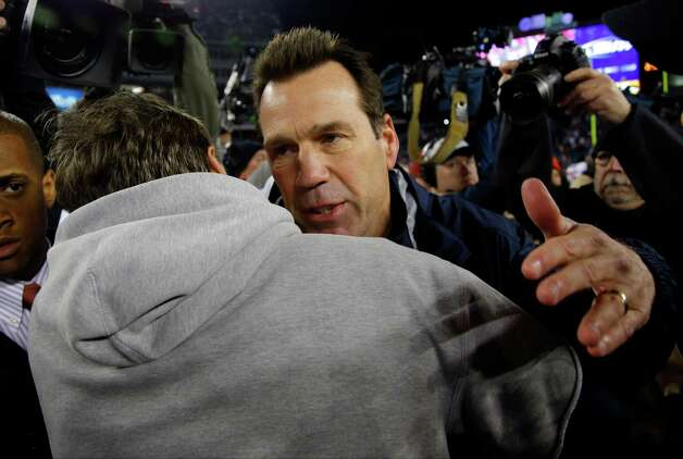 Houston Texans head coach Gary Kubiak, right, congratulates New England Patriots head coach Bill Belichick after their AFC divisional playoff NFL football game in Foxborough, Mass., Saturday, Jan. 12, 2013. The Patriots defeated the Texans 41-28. (AP Photo/Stephan Savoia) Photo: Stephan Savoia, Associated Press / AP