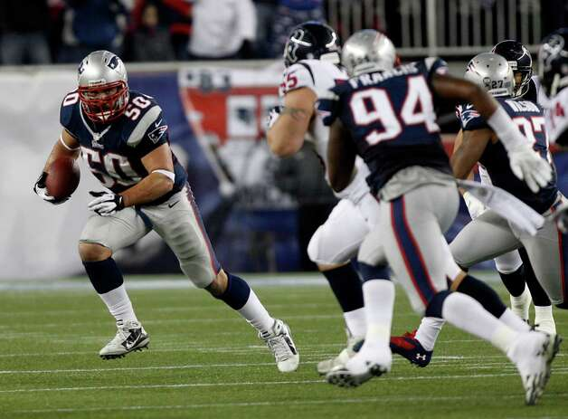 New England Patriots defensive end Rob Ninkovich (50) runs with the ball after intercepting a pass intended for Houston Texans fullback James Casey during the second half of an AFC divisional playoff NFL football game in Foxborough, Mass., Sunday, Jan. 13, 2013. (AP Photo/Stephan Savoia) Photo: Stephan Savoia, Associated Press / AP