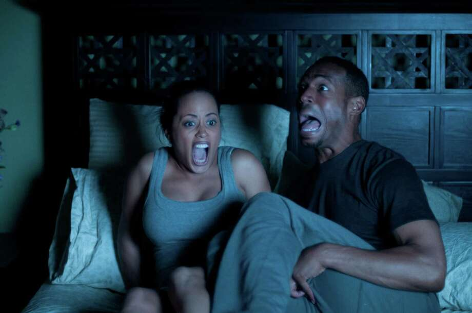 "This film image released by Open Road Films shows Essence Atkins, left, and Marlon Wayans in a scene from ""A Haunted House."" (AP Photo/Open Road Films, Will McGarry) Photo: Will McGarry"