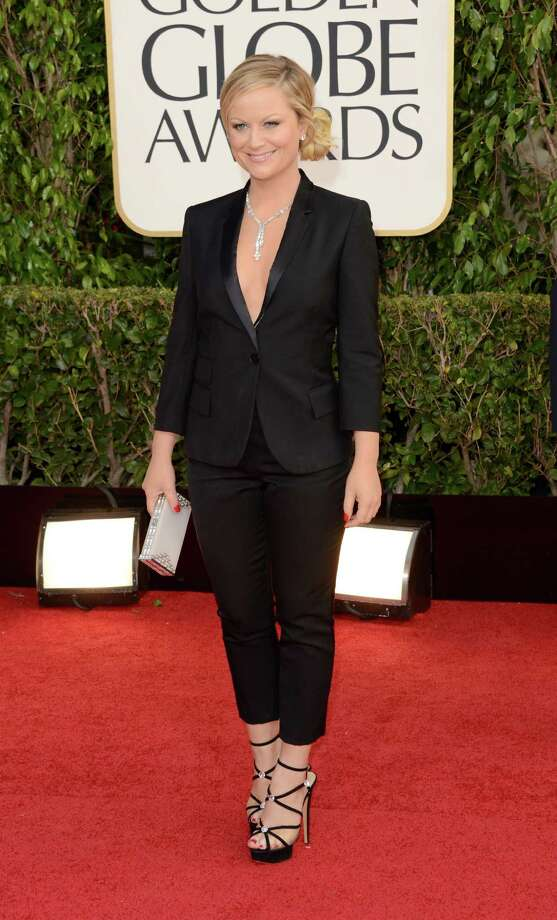 Worst: Thank goodness co-host Amy Poehler changed into something nicer for the show. Not a fan of the blazer worn over a bare torso; if you want to show cleavage, there are a million better ways than this. Photo: Jason Merritt, Getty Images / 2013 Getty Images