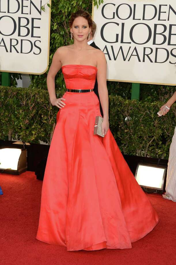 On the fence: Jennifer Lawrence's dress looks great from the front; it certainly fits her like a glove and is a great color to boot. But ... Photo: Jason Merritt, Getty Images / 2013 Getty Images