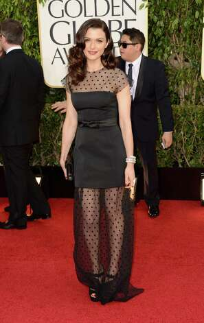 Worst: Rachel Weisz is wearing a cocktail dress that's been faked into a gown with the addition of the never-popular sheer, polka-dotted material. This is what your mother would do if you needed a prom dress on the cheap and had some extra material lying around. Photo: Jason Merritt, Getty Images / 2013 Getty Images