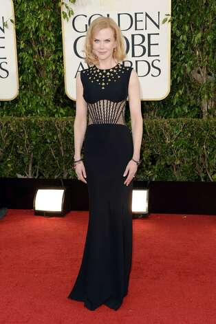 Worst: Another gown that doesn't know what it wants to be. Is it a daring, lacy, midriff-baring chance taker or a long, sleek, elegant black gown with interesting gold leaf detailing around the shoulders? From the look on Nicole Kidman's face, even she doesn't know. Photo: Jason Merritt, Getty Images / 2013 Getty Images
