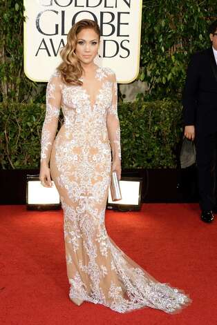 Best: Jennifer Lopez can often become her own cliche; that's what happens when you have a famous body and you've worn famously daring gowns on it. But this beautiful creation falls right in the butter zone where good taste rules over all.  Photo: Jason Merritt, Getty Images / 2013 Getty Images