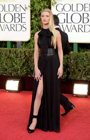 Worst: Rosie Huntington-Whiteley wears ... well, something. It looks like she forgot to remove the napkin from her neck when she got up from dinner, although it does match the rest of the dress. Oversized leather belt, check ... Jolie leg slit, check ... this outfit doesn't know what it wants to be when it grows up. Photo: Jason Merritt, Getty Images / 2013 Getty Images