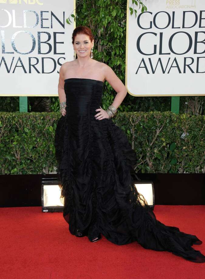 Worst: Debra Messing could have used a necklace her, or her hair down -- anything to detract from the way this gown makes her look wider than she is. Photo: Jordan Strauss/Invision/AP