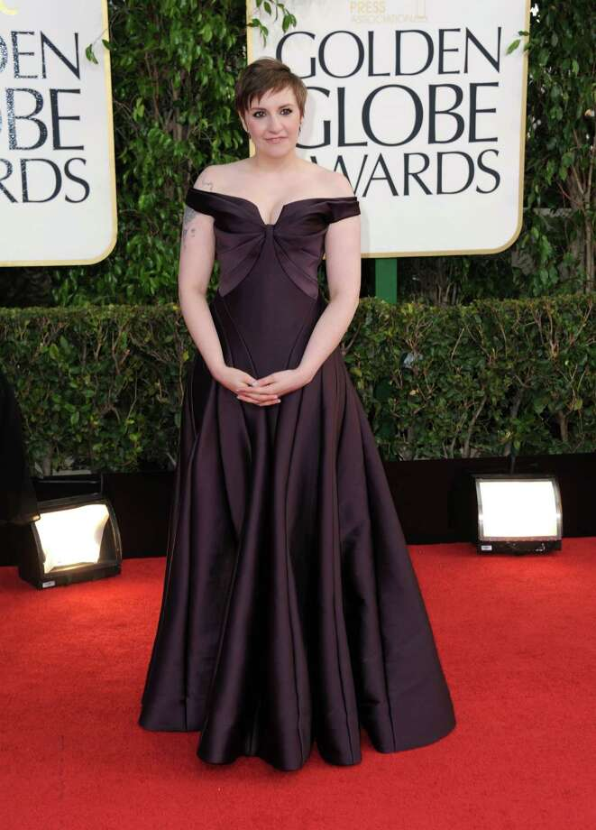 Worst:Lena Dunham could have pulled this off with a different approach to the shoulders. This gown makes her look like she's wearing a huge pair of aviator's wings. Photo: Jordan Strauss/Invision/AP