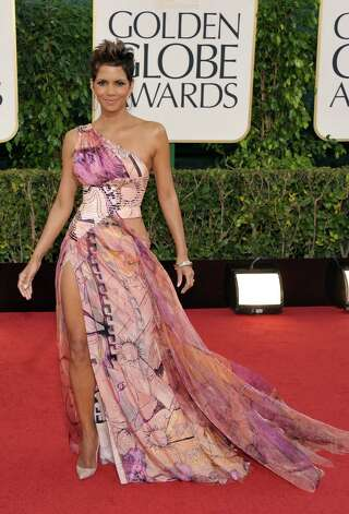 Worst: Ugh. Halle Berry is gorgeous but she barely comes through this cacophonous monstrosity. That print and the colors in it are an absolute nightmare, and by our count she's showing both shoulders, one waist/hip combination and a mile of leg. This is not flattering at all on someone who should be knocking it out of the park every single time. Photo: John Shearer/Invision/AP