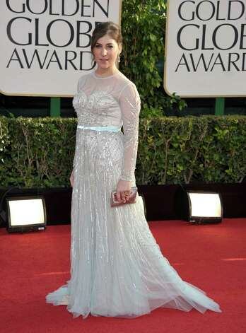 Worst: It's tough to pick on Mayim Bialik, who does not cut a traditionally glamorous image to start with. But she didn't do herself any favors here. A darker dress would have worked better, and you can't call attention to the fact that you don't have a well-defined waist by wearing a gown with a high-waisted accent. Photo: John Shearer/Invision/AP