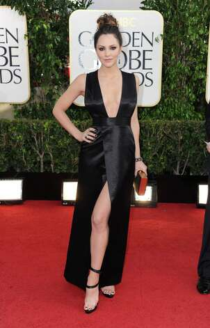 "Worst: Oh holy cow, this is awful on former ""American Idol"" star Katharine McPhee. It's black. It's shiny. It's too revealing. And it's beginning to become annoying that some of these celebrities are mimicking Angelina Jolie's leg-exposing look from last year's Oscars. Photo: Jordan Strauss/Invision/AP"