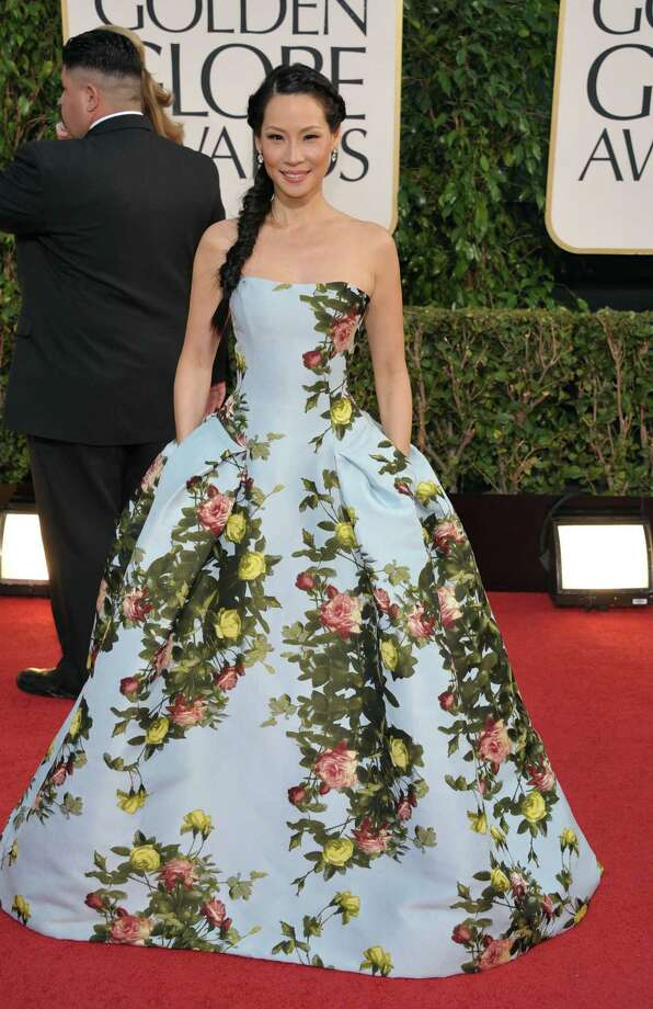 Best: Normally these kinds of prints don't play well on the red carpet, and there will undoubtedly be some who will take issue with Lucy Liu's choice. But this seems like the early arrival of spring, a welcome thought at this time of year, and the base shade of the gown is just right. Plus, she did exactly what she should do with that glorious hair -- a long braid over one shoulder. Photo: John Shearer/Invision/AP
