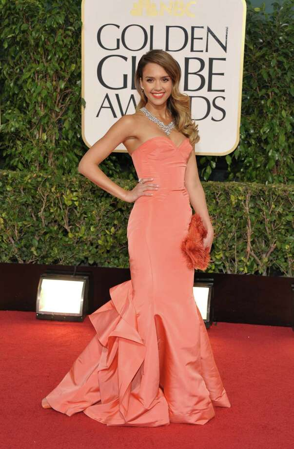 Best: This is a familiar look on Jessica Alba, but that doesn't take away from the perfect execution. The coral color is jujst right for her skin tone and her hair has that classic '40s look. Photo: John Shearer/Invision/AP