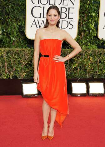 Best: Marion Cotillard wears Dior Haute Couture, and again, simplicity rules the day. You start with a beautiful actress, put a well-tailored dress on her in a gorgeous color -- with one truly fetching detail, its assymetry -- and let the rest speak for itself. Well done. Photo: John Shearer/Invision/AP