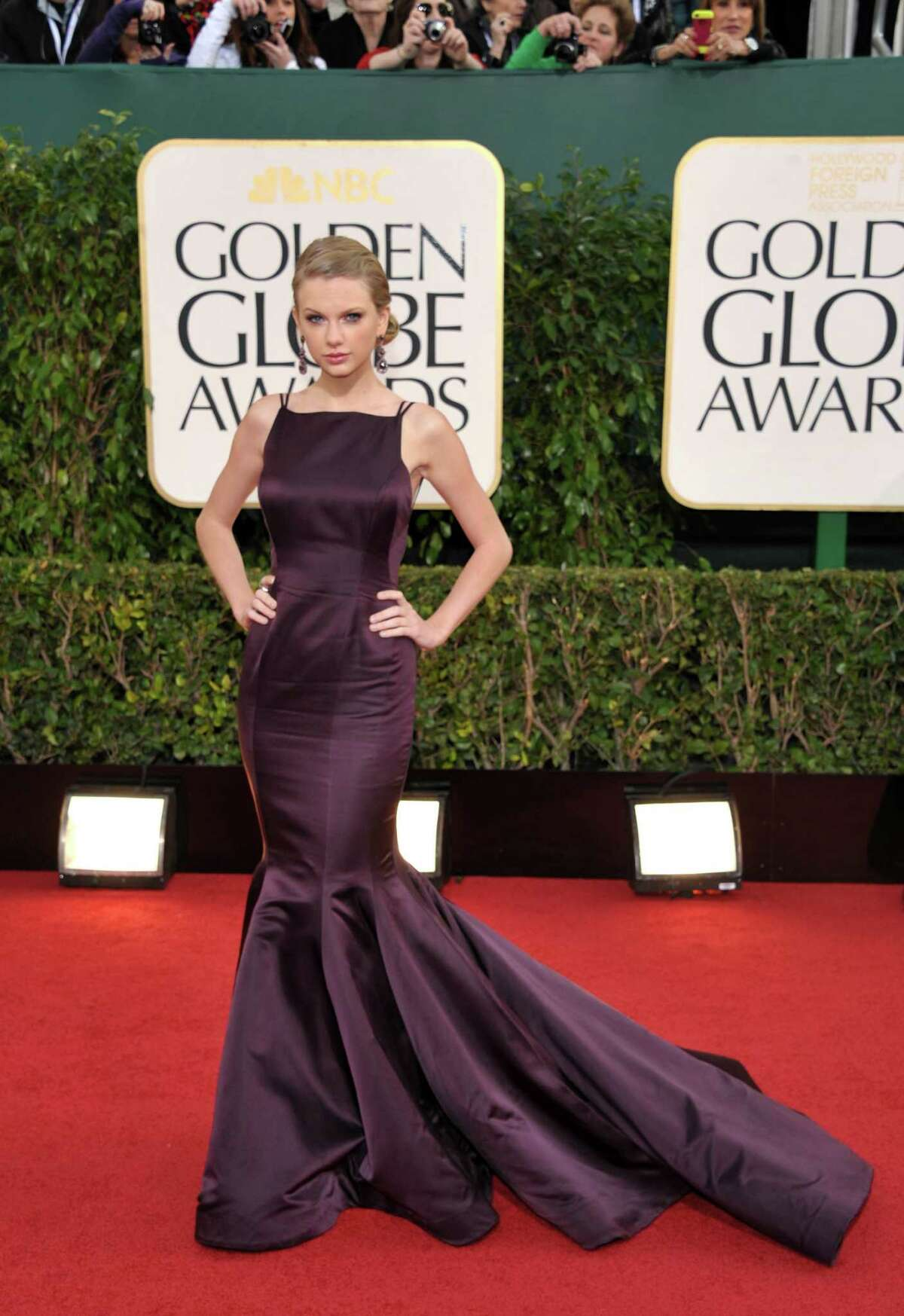 Best: Hitting the right note on the red carpet is partly about understanding the significance of the event -- the Golden Globes are a big deal in Hollywood -- but mostly about choosing the right dress for the occasion and then accessorizing appropriately. Taylor Swift (or her stylist) understood this perfectly with this Donna Karan Atelier creation in purple, a color not frequently seen on the red carpet. The dress is bold enough to require little extra effort on her part, and she got out of the way and let it speak for itself.