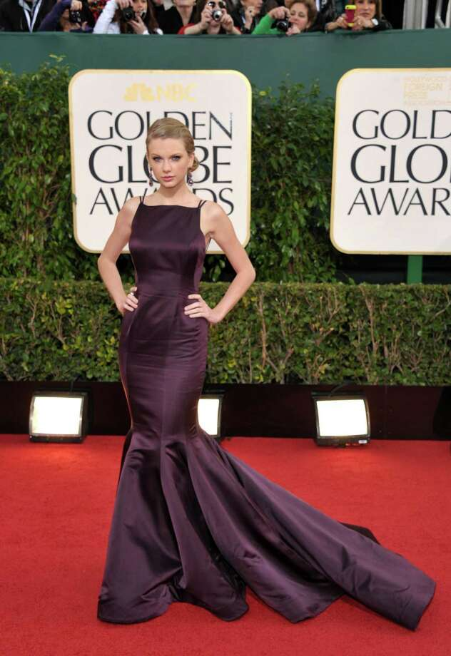 Best: Hitting the right note on the red carpet is partly about understanding the significance of the event -- the Golden Globes are a big deal in Hollywood -- but mostly about choosing the right dress for the occasion and then accessorizing appropriately. Taylor Swift (or her stylist) understood this perfectly with this Donna Karan Atelier creation in purple, a color not frequently seen on the red carpet. The dress is bold enough to require little extra effort on her part, and she got out of the way and let it speak for itself. Photo: John Shearer/Invision/AP