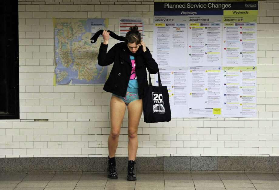 A rider in the New York City subway take part in the 2013 No Pants Subway Ride on Sunday. (AFP PHOTO / TIMOTHY A. CLARY) Photo: Getty