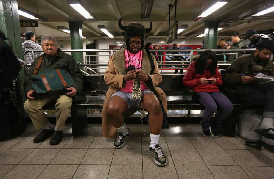 A pantless man knits at the Union Square subway station on Sunday in New York City.  Photo: John Moore, Getty / 2013 Getty Images