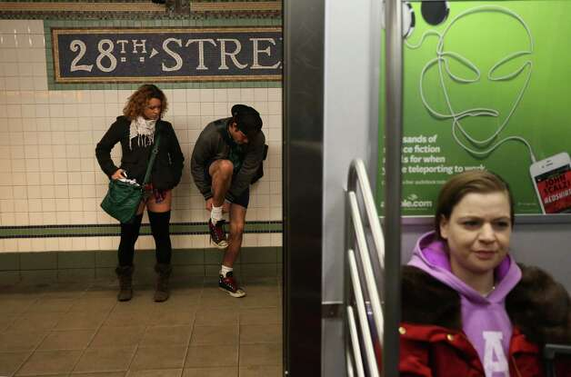Pantless people stand on a subway platform on Sunday in New York City.  Photo: John Moore, Getty / 2013 Getty Images