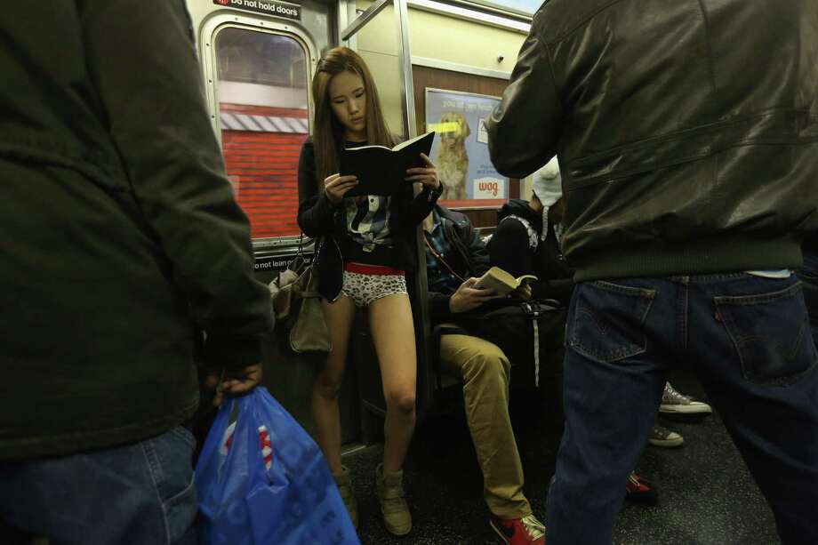 People ride the subway pantless on Sunday in New York City.  Photo: John Moore, Getty / 2013 Getty Images