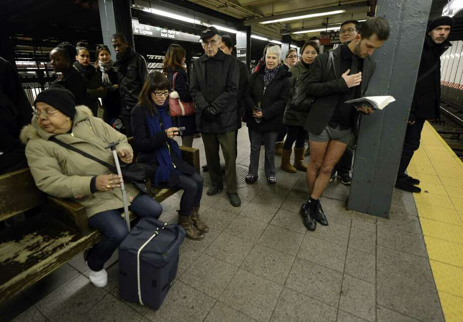 Riders in the New York City subway take part in the 2013 No Pants Subway Ride on Sunday. (AFP PHOTO / TIMOTHY A. CLARY) Photo: Getty