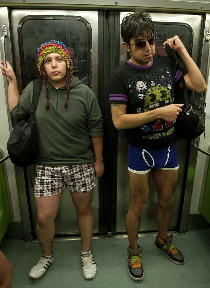 Two young men ride the subway during the worldwide 'No Pants Subway Ride' event  in Mexico City on Sunday. (AFP PHOTO/RONALDO SCHEMIDT) Photo: RONALDO SCHEMIDT, Getty / 2013 AFP