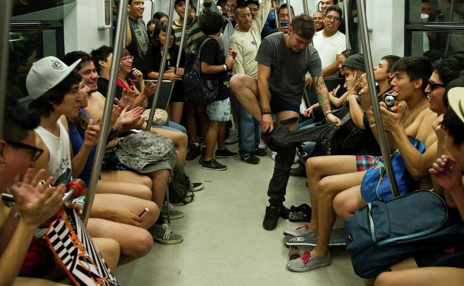 People ride a subway train during the worldwide 'No Pants Subway Ride' event  in Mexico City on Sunday. (AFP PHOTO/RONALDO SCHEMIDT) Photo: RONALDO SCHEMIDT, Getty / 2013 AFP