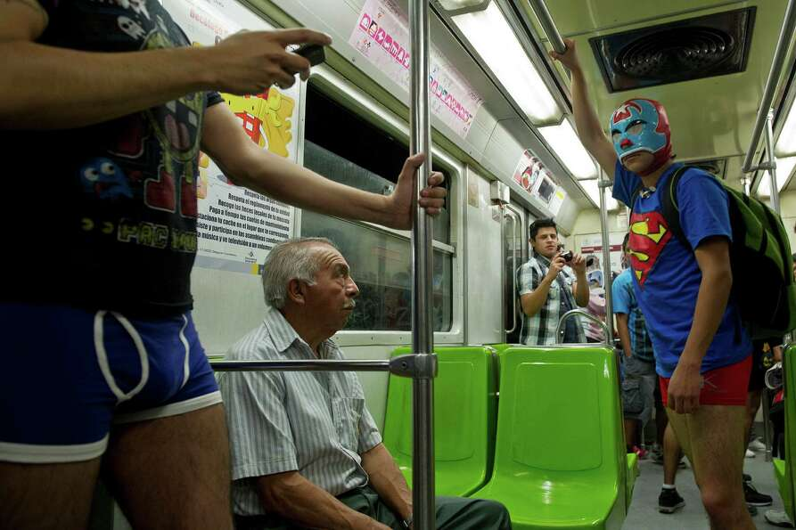 People ride a subway train during the worldwide 'No Pants Subway Ride' event  in Mexico City on Sund