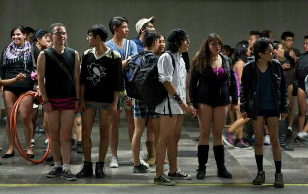 People wait for the train at a subway station during the worldwide 'No Pants Subway Ride' event  in Mexico City on sunday. (AFP PHOTO/RONALDO SCHEMIDT) Photo: RONALDO SCHEMIDT, Getty / 2013 AFP