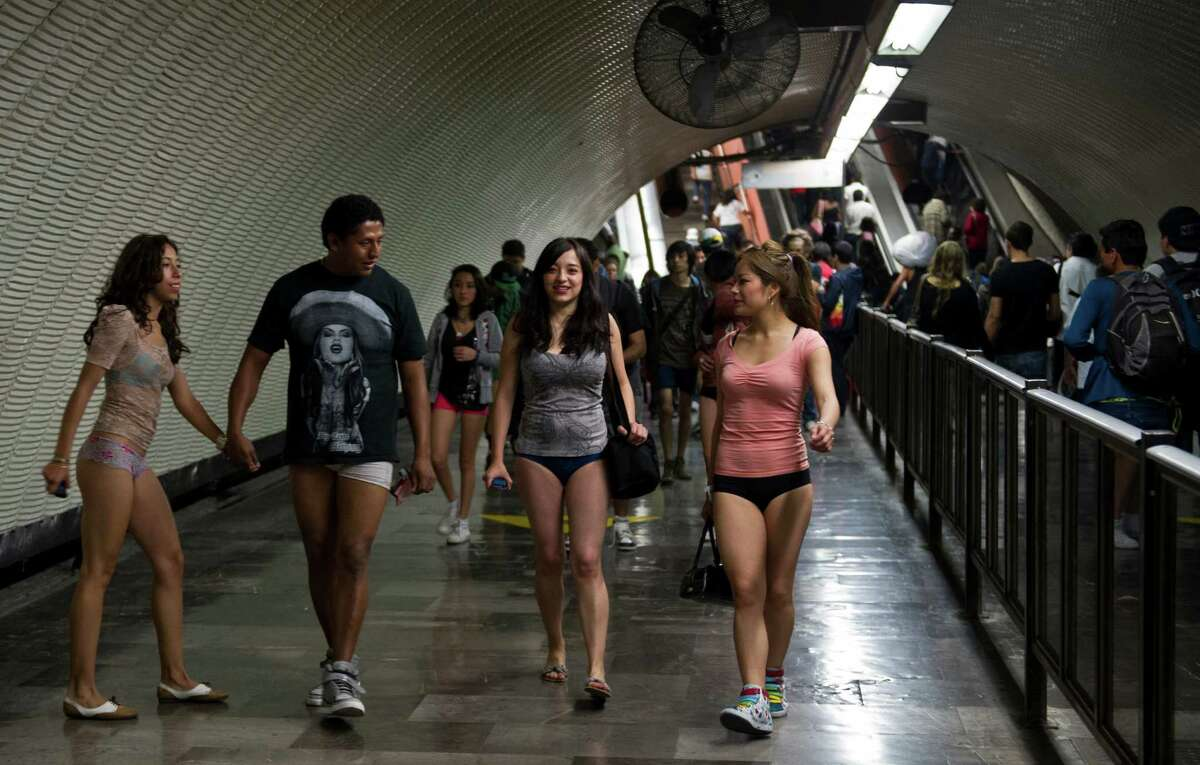 People walk through a subway station during the worldwide 'No Pants Subway Ride' event in Mexico City on Sunday. (AFP PHOTO/RONALDO SCHEMIDT)
