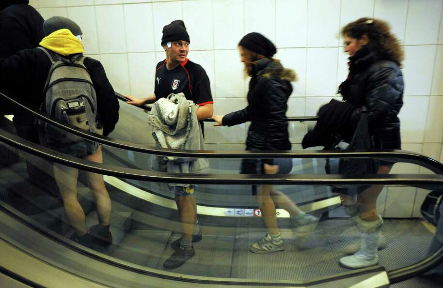 People take an escalator in underwear in the Sofia City subway as they take part in the 2013 No Pant
