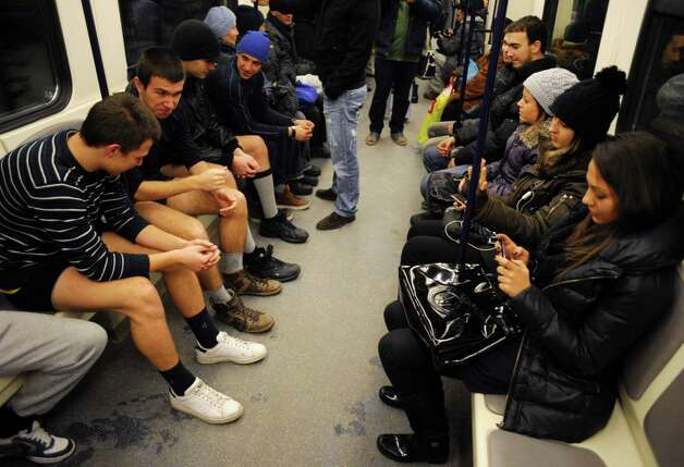 People sit in underwear in the Sofia City subway as they take part in the 2013 No Pants Subway Ride on Sunday in the Bulgarian capital. (AFP PHOTO / NIKOLAY DOYCHINOV) Photo: Getty