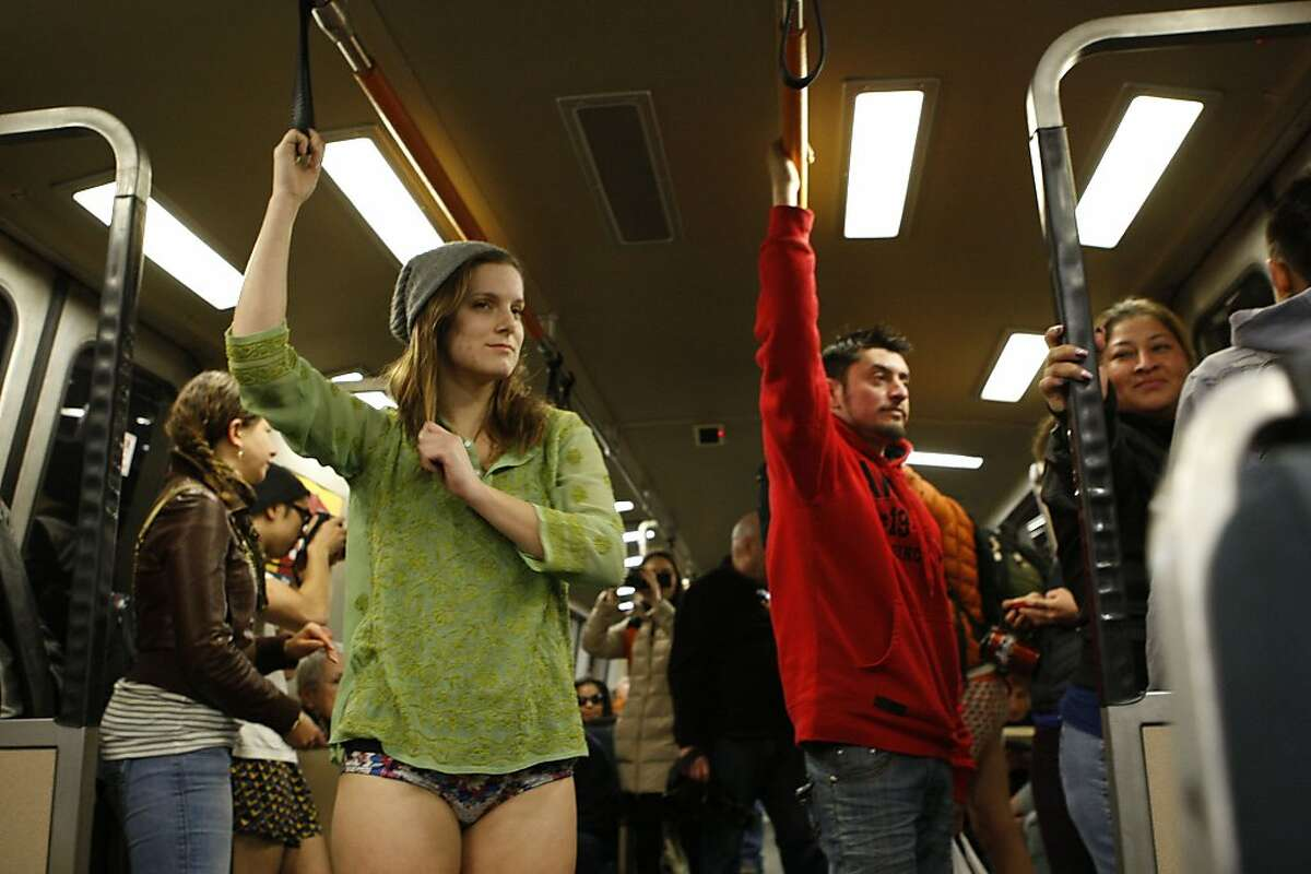 """""""No Pants"""" participant Michelle Pancake, from Thousand Oaks, rides the BART in her underwear on January 13, 2013 in San Francisco, Calif. The event, which takes place in various subways around the world is hosted by the group Improv Everywhere, and asks participants to wear no pants but to don colorful underwear and socks."""