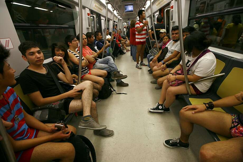 "Participants in the annual ""No Pants Subway Ride"" ride a train in Mexico City, Sunday, Jan. 13, 2013. (AP Photo/Marco Ugarte) Photo: Marco Ugarte, Associated Press"