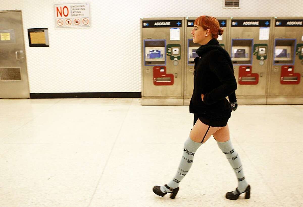"""""""No Pants"""" participant Katherine Kwid, of San Francisco, walks through the Montgomery BART station in her underwear on January 13, 2013 in San Francisco, Calif. The event, which takes place in various subways around the world is hosted by the group Improv Everywhere, and asks participants to wear no pants but to don colorful underwear and socks."""