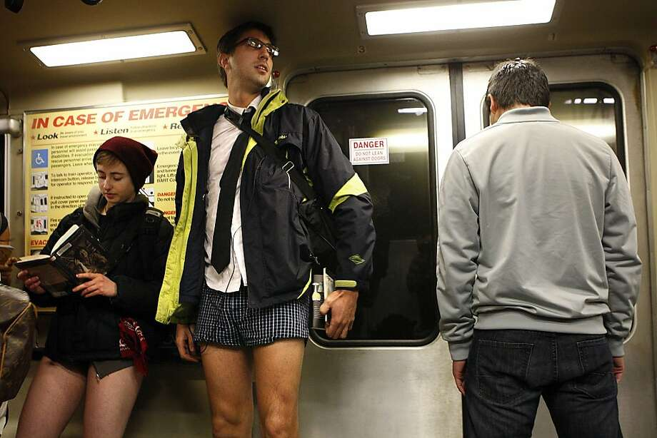 """No Pants"" participants Becca MacFife and Mark Joseph, both of San Francisco, ride the BART in their underwear on January 13, 2013 in San Francisco, Calif. The event, which takes place in various subways around the world is hosted by the group Improv Everywhere, and asks participants to wear no pants but to don colorful underwear and socks. Photo: Sean Havey, The Chronicle"