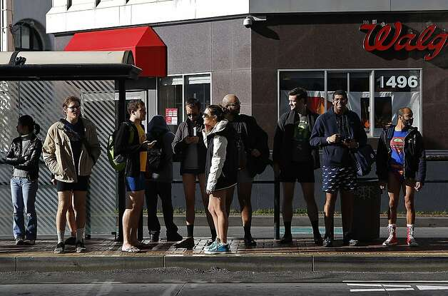 """No Pants"" participants wait for the MUNI along Market on January 13, 2013 in San Francisco, Calif. The event, which takes place in various subways around the world is hosted by the group Improv Everywhere, and asks participants to wear no pants but to don colorful underwear and socks Photo: Sean Havey, The Chronicle"