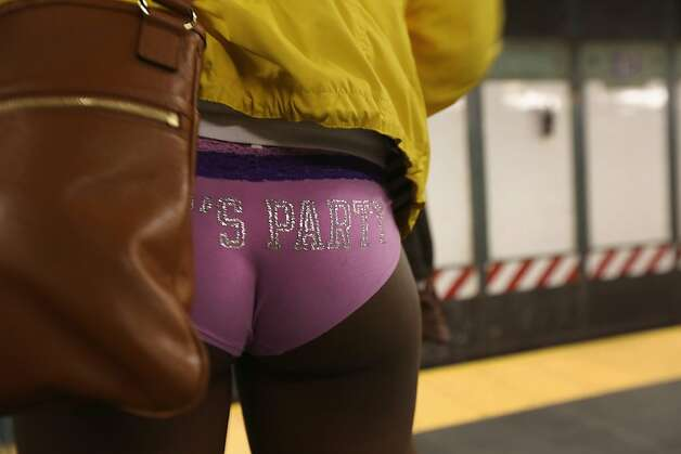 "NEW YORK, NY - JANUARY 13:  A pantless woman stands on a subway platform on January 13, 2013 in New York City. Thousands of people participated in the 12th annual No Pants Subway Ride, organized by New York City prank collective Improv Everywhere. During the afternoon winter event, participants boarded separate subway stops and removed their pants, pretending that they did not know each other. The event, refered to as a ""celebration of silliness"" is designed to make fellow subway riders laugh and smile.  (Photo by John Moore/Getty Images) Photo: John Moore, Getty Images"