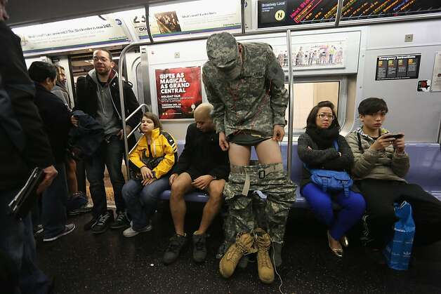"NEW YORK, NY - JANUARY 13:  A soldier remomes his pants on the subway on January 13, 2013 in New York City. Thousands of people participated in the 12th annual No Pants Subway Ride, organized by New York City prank collective Improv Everywhere. During the afternoon winter event, participants boarded separate subway stops and removed their pants, pretending that they did not know each other. The event, refered to as a ""celebration of silliness"" is designed to make fellow subway riders laugh and smile.  (Photo by John Moore/Getty Images) Photo: John Moore, Getty Images"