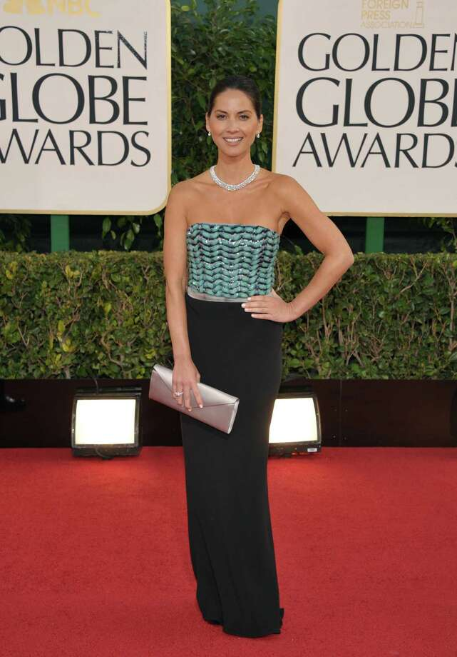 Actress Olivia Munn arrives at the 70th Annual Golden Globe Awards at the Beverly Hilton Hotel on Sunday Jan. 13, 2013, in Beverly Hills, Calif. Photo: AP