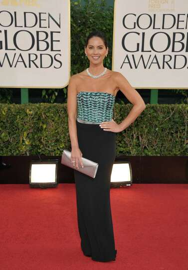 Actress Olivia Munn arrives at the 70th Annual Golden Globe Awards at the Beverly Hilton Hotel on Su
