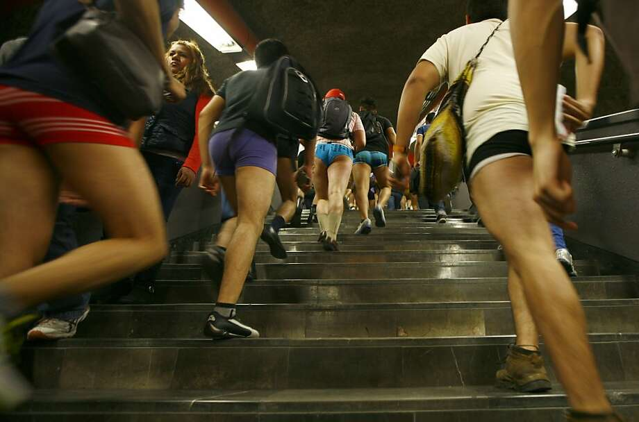 "Participants in the annual ""No Pants Subway Ride"" transfer to another train at a subway station in Mexico City, Sunday, Jan. 13, 2013. (AP Photo/Marco Ugarte) Photo: Marco Ugarte, Associated Press"