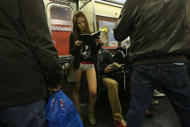 "NEW YORK, NY - JANUARY 13:  People ride the subway pantless on January 13, 2013 in New York City. Thousands of people participated in the 12th annual No Pants Subway Ride, organized by New York City prank collective Improv Everywhere. During the afternoon winter event, participants boarded separate subway stops and removed their pants, pretending that they did not know each other. The event, refered to as a ""celebration of silliness"" is designed to make fellow subway riders laugh and smile.  (Photo by John Moore/Getty Images) Photo: John Moore, Getty Images"